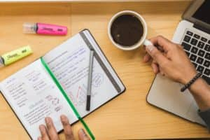 Open Notebook and Coffee Cup